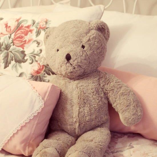 A vintage teddy bear child's toy.