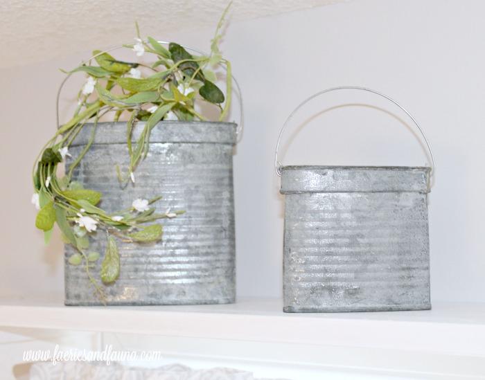Galvanized metal ornaments sitting on a diy farmhouse style window shelf. DIYwindow shelf, DIYwindow rod, DIYwindow treatment,