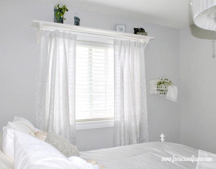 A DIY farmhouse style window shelf with a curtain rod, and pretty farmhouse decor. Farmhouse, DIY, Woodworking, DIYwindow shelf, DIYwindow rod, DIYwindow treatment,