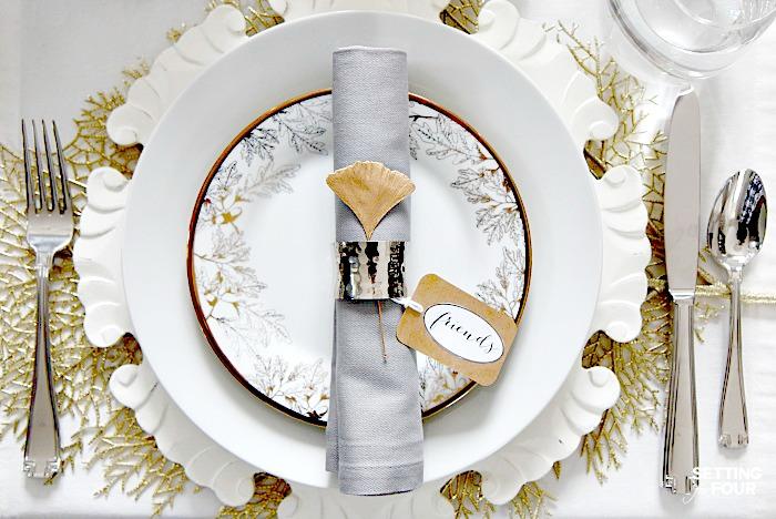Elegant fall decor tablescape with brilliant white dishware.