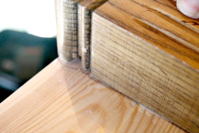 A headboard bench idea being made using a twin wood headboard