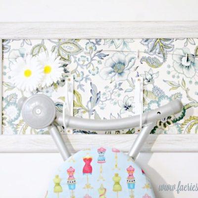 DIY Ironing Board Hanger for Pretty Laundry Room Organization