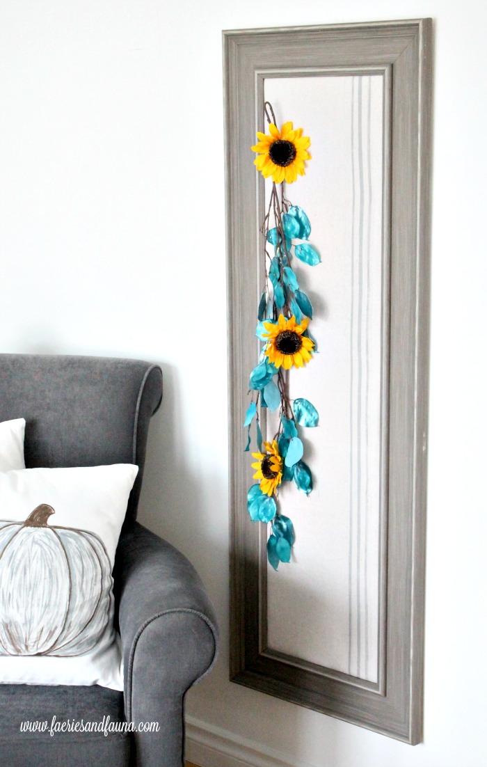 Full length decorative bulletin board using flowers.