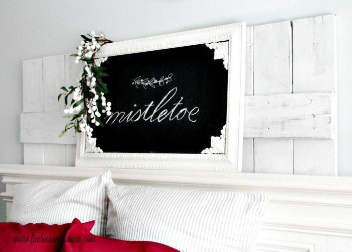 Christmas chalkboard sign that says mistletoe.
