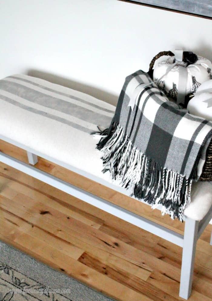 Drop cloth covered farmhouse bench.