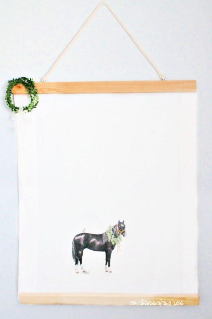 A handmade farmhouse art piece using an equine towel.