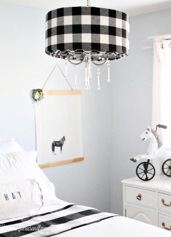 A farmhouse styled bedroom featuring a DIY farmhouse art project