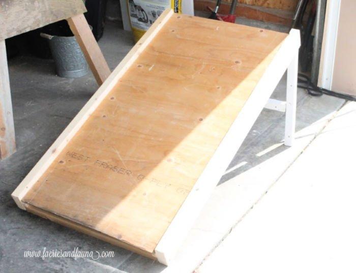 Adding plywood to a DIY dog ramp.