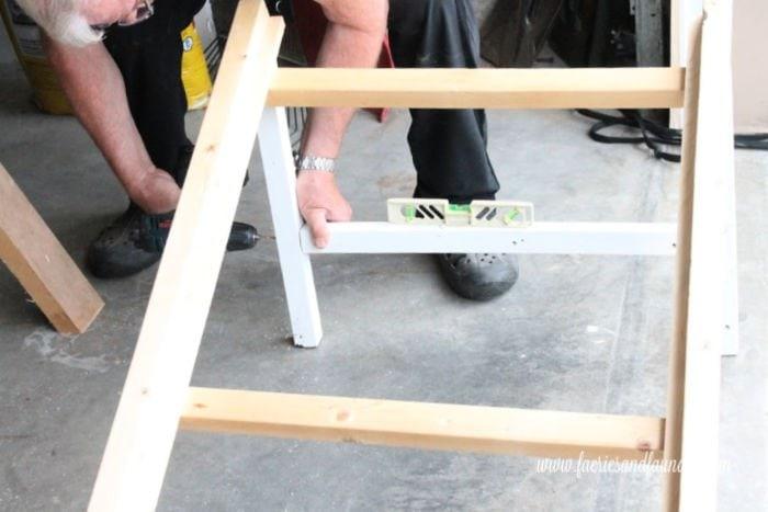 Adding braces for extra strength on a DIY dog ramp.