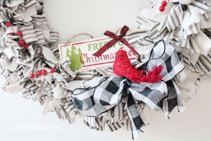 A DIY rag wreath decorated to be a Christmas rag wreath