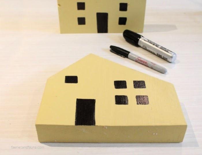 DIY scrap wood mini house craft idea for farmhouse decor.