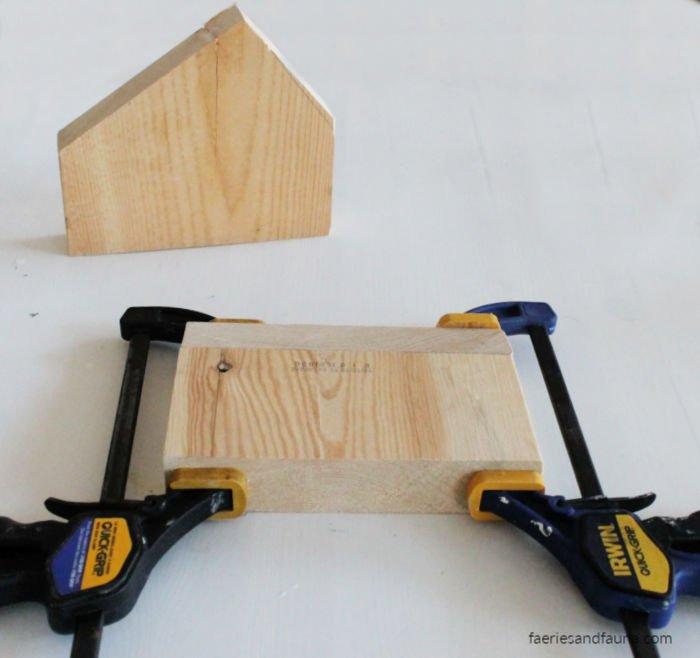 Clamping scrap wood togethernfor making mini house farmhouse decor.